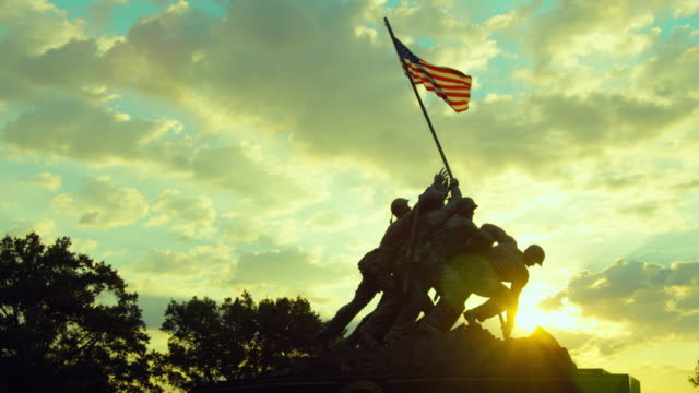 pan left to right: iwo jima memorial against sunset (shot on red) - arlington virginia stock videos & royalty-free footage