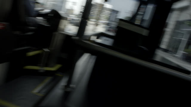pan left to right moving pov from bus driving through city streets. - bicycle parking station stock videos and b-roll footage