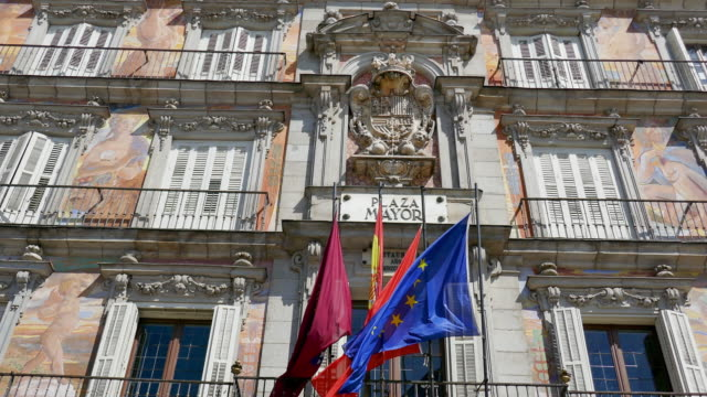 Pan Left to Right: Plaza Mayor's Flags in Madrid