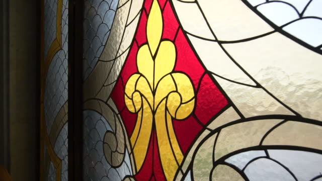 pan left to right slow: beautifully designed stained glass touched by the light of the sun - kazan, russia - kirche stock-videos und b-roll-filmmaterial