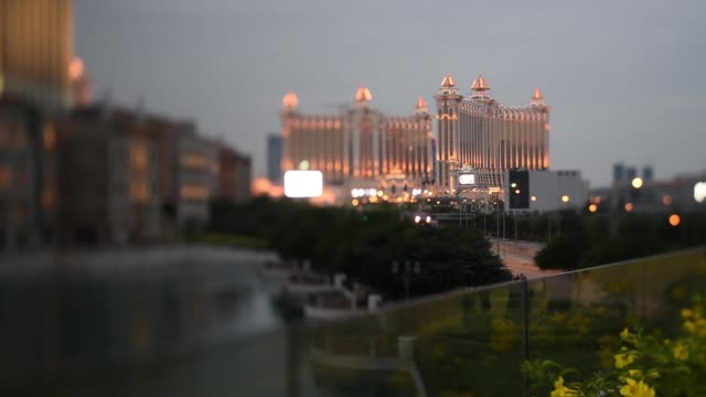 Pan left to right the Venetian Macao resort and casino operated by Sands China Ltd a unit of Las Vegas Sands Corp and the Galaxy Macau casino and...