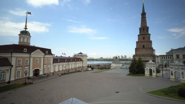 pan left to right: triangular building in the midst of the normal buildings with water in the background - kazan, russia - kazan russia stock videos and b-roll footage