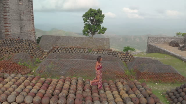 pan left to right: woman walking on the cannonballs of citadel laferriere - imperfection stock videos and b-roll footage