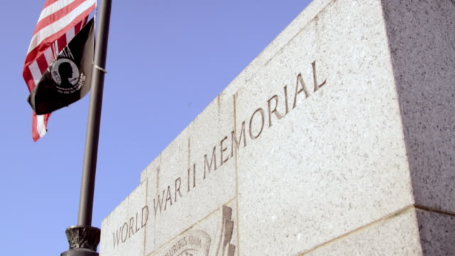 pan left to right: world war ii memorial and flag (shot on red) - wall building feature stock videos and b-roll footage