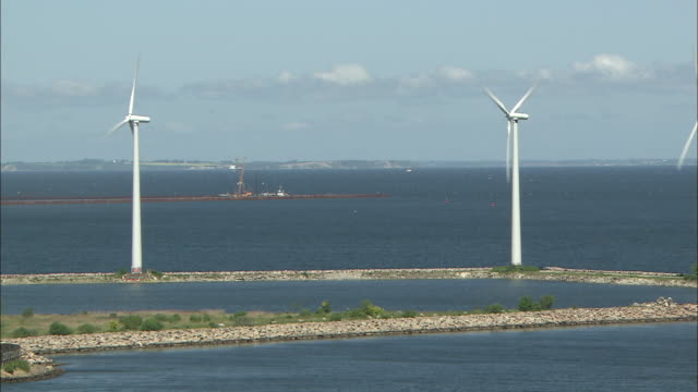 pan left ws wind turbines in copenhagen port - environment or natural disaster or climate change or earthquake or hurricane or extreme weather or oil spill or volcano or tornado or flooding stock videos & royalty-free footage