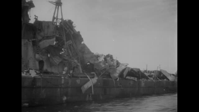 pan length of uss saratoga superstructure blown off in blast / navy secretary james forrestal and admiral william blandy on deck of ship looking at... - bikini atoll stock videos & royalty-free footage