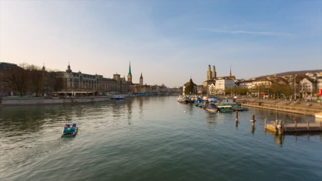 Pan Limmat River and Zurich skyline with Grossmuenster Cathedral