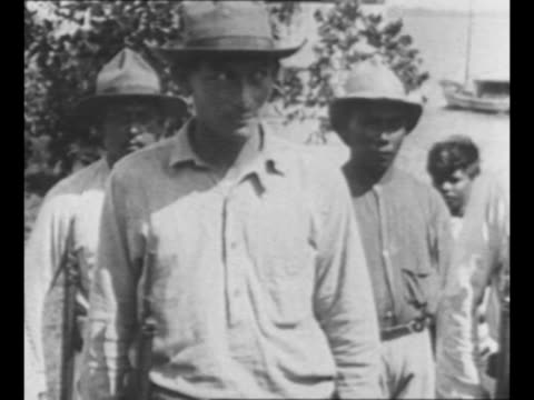 pan line of nicaraguan rebels / rebels march in drill at side of house / from greatest headlines of the century series / note: [exact dates not known] - ニカラグア点の映像素材/bロール