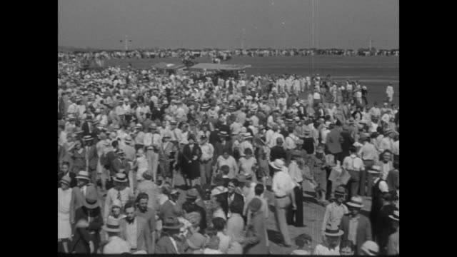 pan line of some of the 20 female pilots in the women's air derby race / vs huge crowd on airfield for race / vs planes take off one at a time - 1929 stock videos & royalty-free footage
