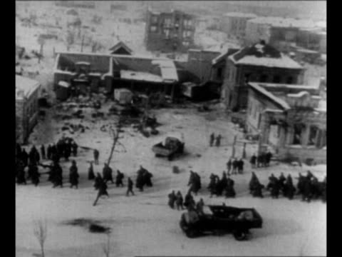 pan line of surrendered german troops moves through snowy street in stalingrad after german surrender there / black / end credits / from greatest... - wehrmacht stock videos & royalty-free footage
