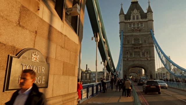 Pan LR across Tower Bridge to City Hall and the Shard at sunset, London, UK