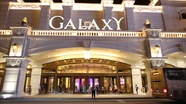 pan l-r entrance to galaxy entertainment group ltd.'s galaxy macau casino resort at night in macau, china, on sunday, aug. 4 pan entrance to galaxy... - macao stock videos & royalty-free footage