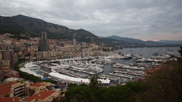 pan lr hotels and residential property to superyachts and other vessels moored in the port hercules harbor ahead of day one of the monaco yacht show... - 見渡す点の映像素材/bロール