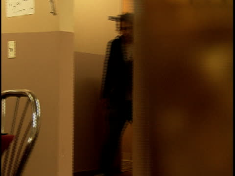 stockvideo's en b-roll-footage met pan medium shot man exits restaurant bathroom, sits at table, leaves restaurant - alleen mid volwassen mannen