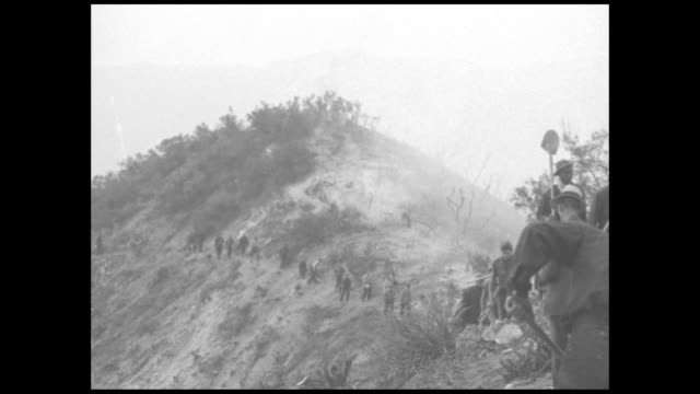 pan men walk up hill ridge with shovels, men on ridge in bkgd fight fire / firefighters shoveling in cloud of smoke / burning wood on hillside / men... - western usa stock videos & royalty-free footage