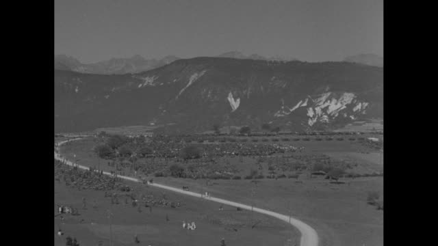vídeos de stock, filmes e b-roll de pan mountains of the italian alps in northern italy with italian army personnel and tanks scattered in front / italian military officers stand with... - benito mussolini