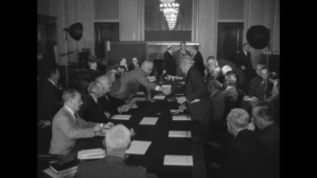 stockvideo's en b-roll-footage met pan new senators standing with hands raised taking oath of office john f kennedy of massachusetts henry jackson of washington prescott bush of... - styles bridges