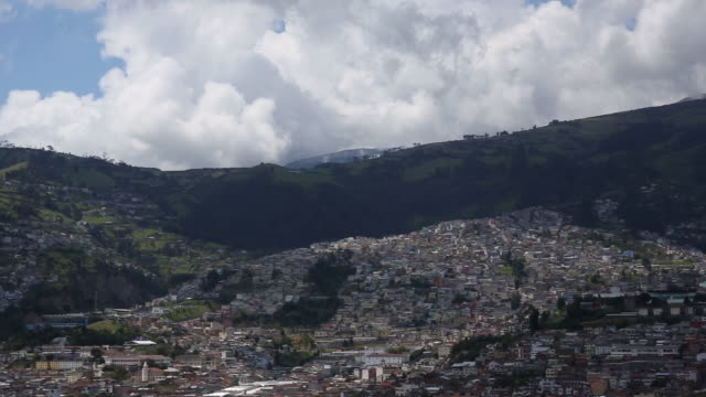 Pan of 180º across city of Quito, and mountain skyline
