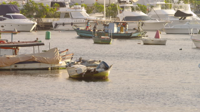 pan of a small boat motoring thought a rio marina. - 2013 stock videos & royalty-free footage