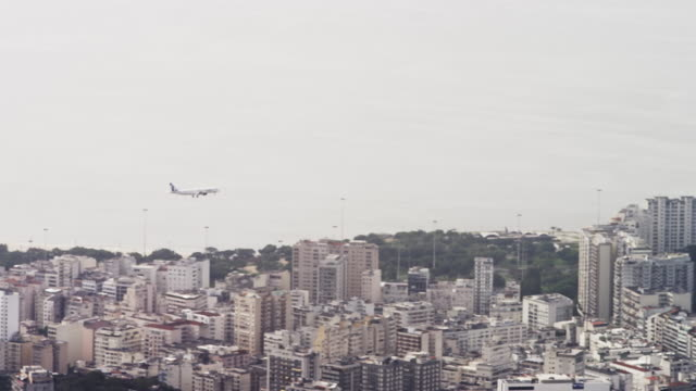 pan of an airliner flying over rio de janeiro. - 2013 stock videos & royalty-free footage