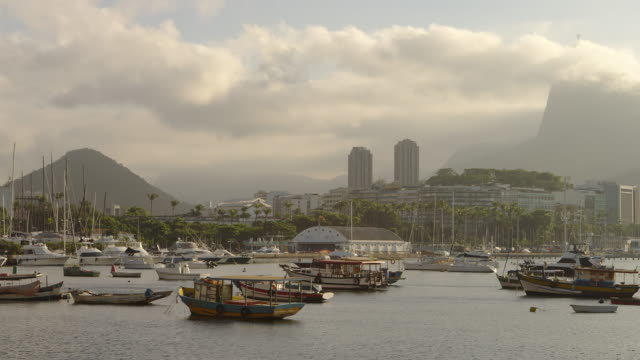 pan of anchored boats in a hazy rio marina. - 2013 stock videos & royalty-free footage
