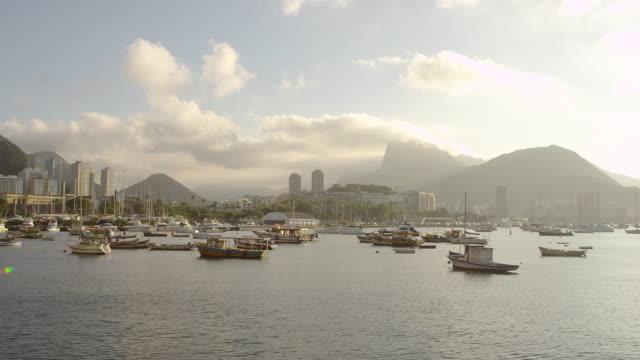 pan of anchored boats in a hazy rio marina. - 2013 stock-videos und b-roll-filmmaterial