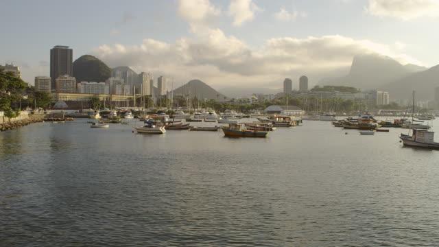 Pan of anchored boats in a hazy Rio marina.
