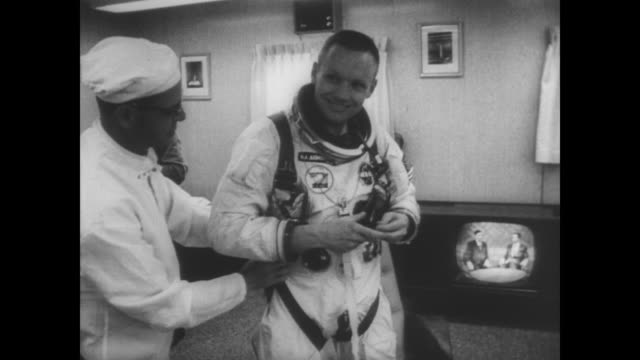 pan of cape kennedy showing launch pads / neil armstrong getting helped into his astronaut suit / armstrong and co-pilot david scott climb into... - nasa video stock e b–roll