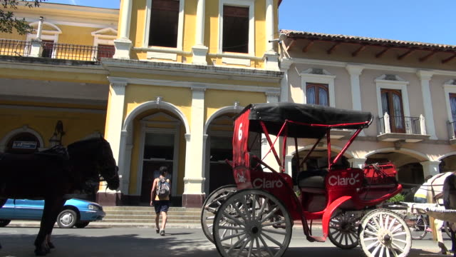 pan of car in front of the cathedral - nicaragua stock videos & royalty-free footage