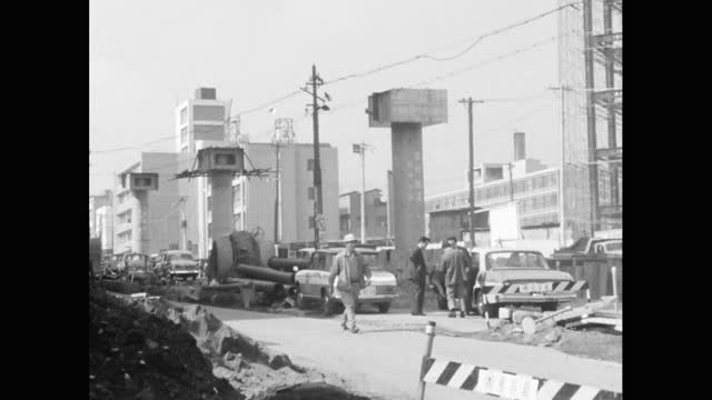 pan of construction work in tokyo street; 1964 - rebuilding stock videos & royalty-free footage