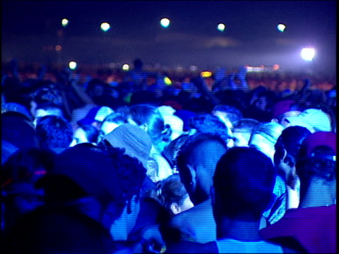 Pan of crowd Dancing at a rave