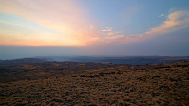 Pan of empty landscape at sunset from summit of Steens Mountain in fall 1