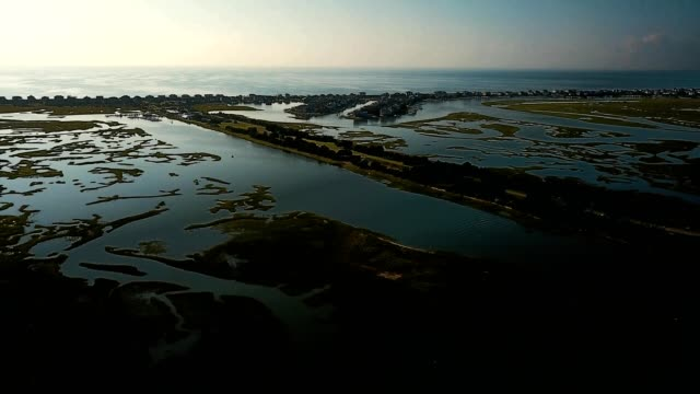 pan of figure 8 island and view of intracoastal waterway - dronebase stock videos and b-roll footage