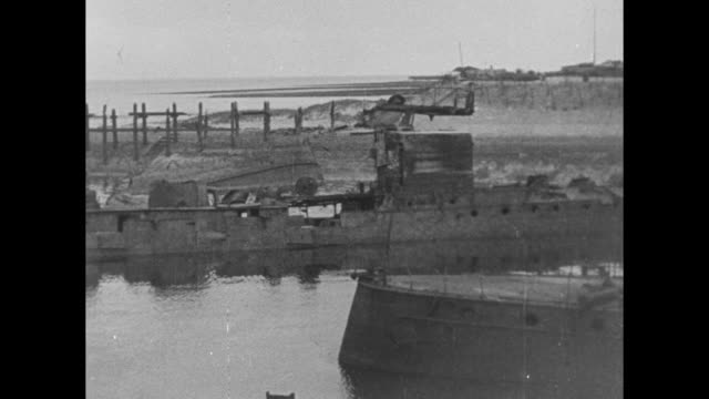 stockvideo's en b-roll-footage met pan of german warships damaged by the british navy in the zeebrugge raid of world war i with the mole seawall in the distance some ships with guns... - zeebrugge