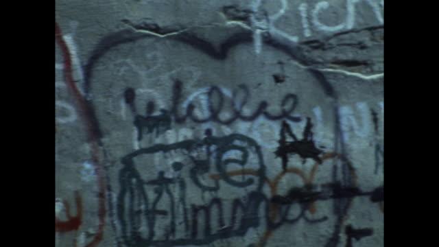 pan of graffiti covered wall in new york city; 1971 - 公共物破壊点の映像素材/bロール