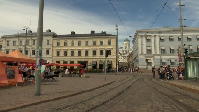 stockvideo's en b-roll-footage met pan of market square in helsinki finland on july 13 2018 - business or economy or employment and labor or financial market or finance or agriculture