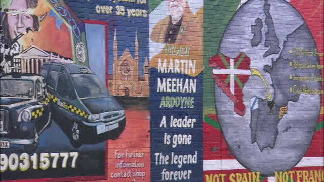 pan of political murals in belfast, northern ireland - politics illustration stock videos & royalty-free footage