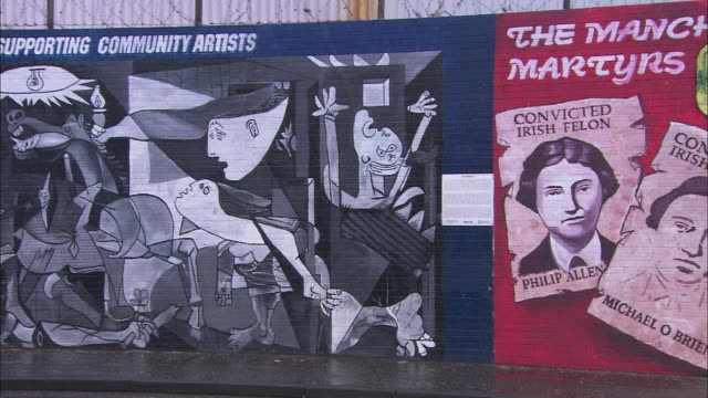 pan of political murals in belfast, northern ireland - belfast stock videos & royalty-free footage