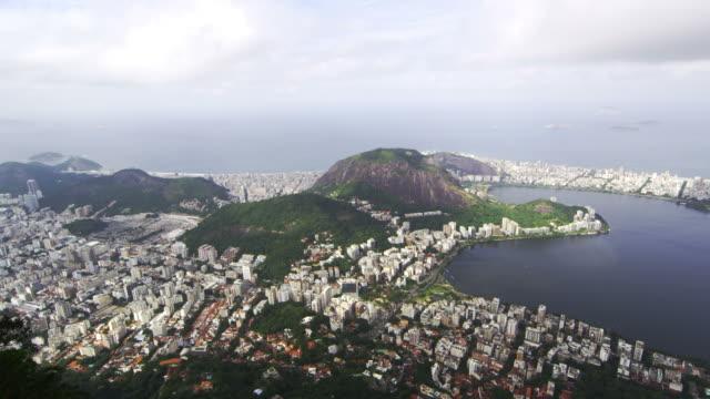 vidéos et rushes de pan of rio de janeiro taken from the top of corcovado mountain. - corcovado