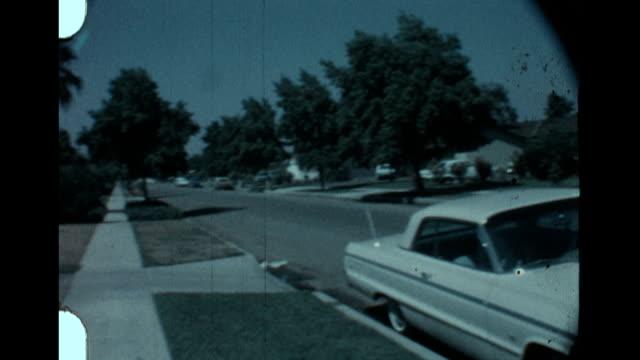 pan of san fernando valley street - anno 1958 video stock e b–roll