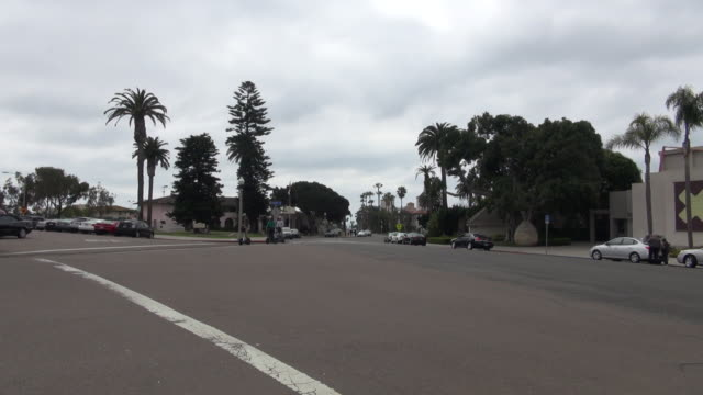 pan of scooters touring la jolla - push scooter stock videos and b-roll footage