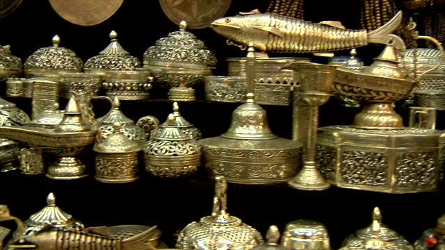 pan of silverware and other ornaments for sale in souk, muscat, oman - souk stock videos & royalty-free footage