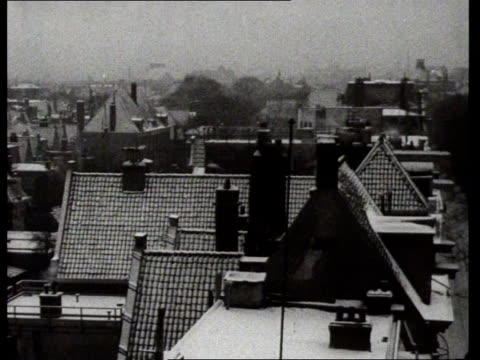 1933 B/W Pan of snowed-covered roofs in Amsterdam / Amsterdam, Noord-Holland, Netherlands