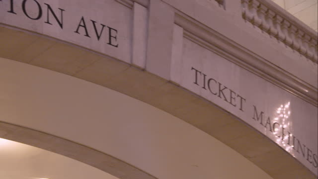 pan of the signs for the ticket machine and lexington avenue in grand central terminal in manhattan - western script stock videos & royalty-free footage