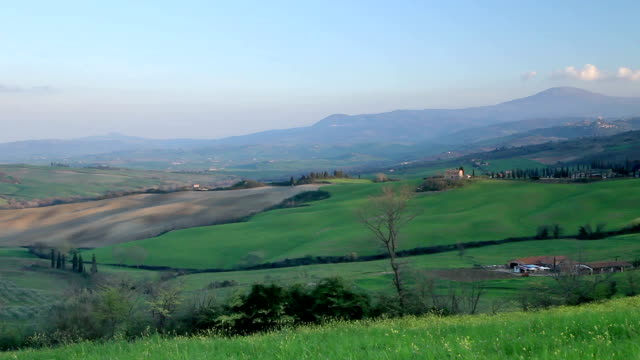 A pan of the Val d'Orcia to Il Belvedere, Tuscany.