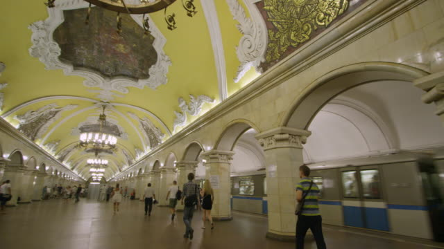 Pan of train arriving in station a Moscow's underground metro