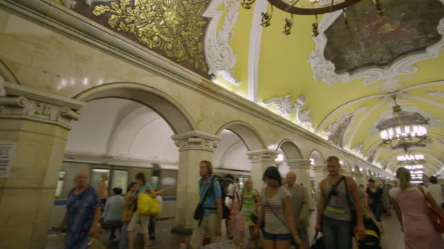 Pan of train departing in station a Moscow's underground metro