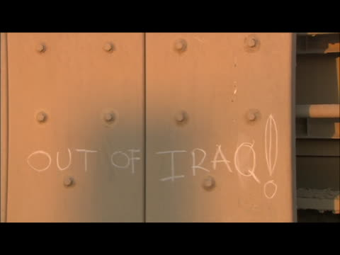 pan of writing on the side of a us military vehicle that reads last vehicle out of iraq on december 18 the last us military convoy group exited iraq... - zuletzt stock-videos und b-roll-filmmaterial