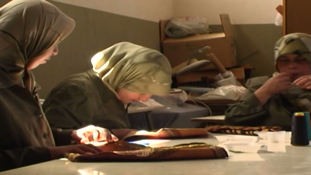 pan on marginalised young women in a sewing class. the mabarrat charity association helps those from underprivileged social backgrounds. - shi'ite islam stock videos & royalty-free footage