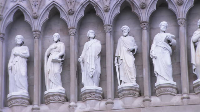 Pan on stone statues on Armagh cathedral, Northern Ireland
